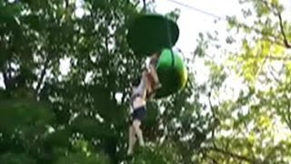 Download Crowd catches girl falling from amusement park ride Video
