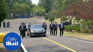 Download Kim Jong Un's body guards run alongside car carrying official - Daily Mail Video