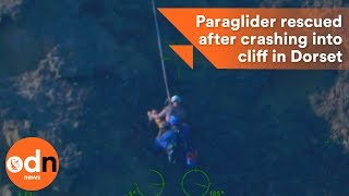 Download Paraglider rescued after crashing into cliff in Dorset Video