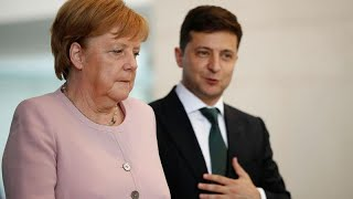 Download Merkel says recovered from shaking bout after drinking water Video