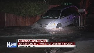 Download Minivan lands on fire hydrant in Spring Valley, water rushes into nearby home Video