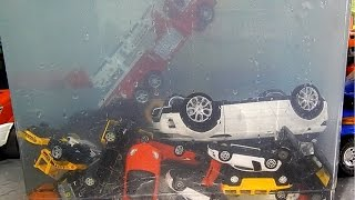 Download Toy cars dive in water. Toy cars jump into the water. Video
