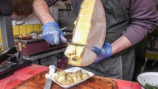 Download Yummy Swiss Raclette. Warm Melted Swiss Cheese with Egg and Potatoes. London Street Food Video