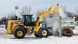 Download Snow Removal from parking lot Cat 966M Video