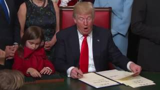 Download President Trump signs his first orders Video