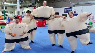 Download FUNNY GYMNASTICS IN GIANT SUMO SUITS! Video