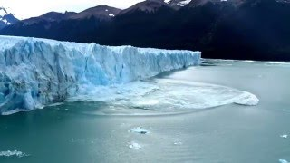 Download Massive wall of ice falls from glacier causing a tsunami-like wave - in HD Video
