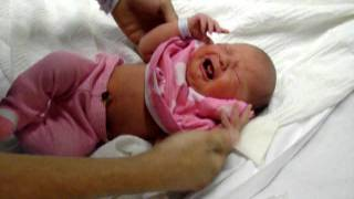Download Newborn Baby girl getting dressed leaving hospital Video