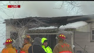 Download Firefighters battle blaze in midst of snow storm Video