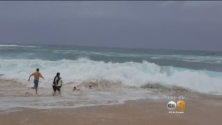 Download Man Saves Boy From Drowning From Powerful Waves Video