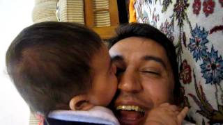 Download Baby licking his dad face, because his gums are itching! Video