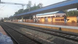 Download 16649 MAQ NCJ Parasuram express arrives at Chengannur station admist announcement. Video