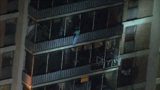 Download Video shows man scale down building during fire Video