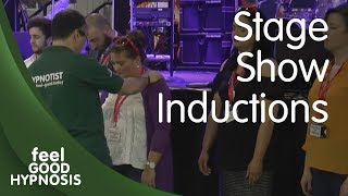 Download Women's knees buckle in hpynosis as hypnotist drops them to the floor in stage show induction Video