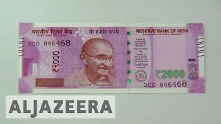 Download India: Cash design of new banknote criticised Video