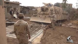Download Mosul: A large tunnel drilling machine used by ISIS is removed by Iraqi army M88 Recovery Vehicle Video