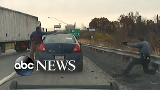 Download Video shows moment traffic stop becomes near-fatal gun battle Video