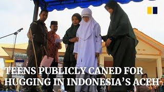 Download Teens publicly caned for hugging in Indonesia's Aceh province Video
