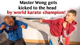 Download Master Wong gets kicked to the head by world karate champion Video