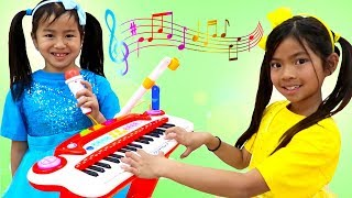 Download Emma & Jannie Pretend Play with Guitar and Drums for Surprise Birthday Party Video