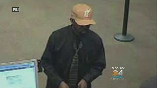 Download FBI Releases Pictures Of Serial Bank Robber On The Run Video