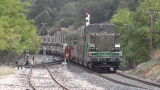 Download Renfe 333-372 con tren militar 97351 pasando por Caracollera. Video