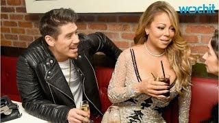 Download Mariah Carey and Bryan Tanaka Share Steamy Kiss Video