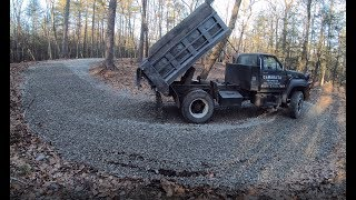Download Delivering gravel to a muddy driveway Video