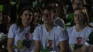 Download Fans cram into Brazil football stadium to mourn dead players Video