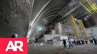 Download Ucrania cubrió al reactor accidentado de la central nuclear de Chérnobil Video