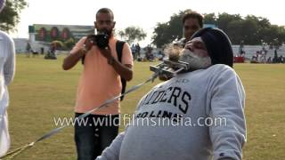 Download Sardarji pulls car with his beard - only in India! Video