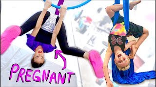 Download PREGNANT LADY DOES ACROBATS WITH CHILD! Video