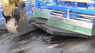 Download 阪神高速、4号湾岸線リニューアル工事を現場公開。「IH式舗装撤去工法」で古い舗装を剥がす -トラベル Watch - Video