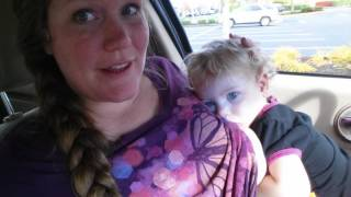 Download Breastfeeding a tired Toddler in the car: use double shirt for successful public breastfeeding Video