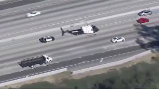 Download Police chase armed robbery suspect through LA streets, freeways Video