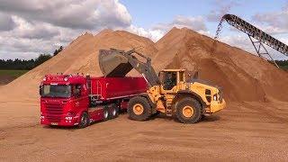 Download Volvo L220H Wheelloader Loading Scania Trucks Video
