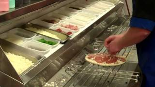 Download How Pizza is Made at Dominos Video