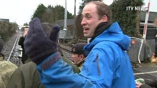 Download Prince William has a go at journalists after helping flood victims Video