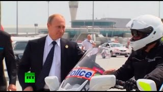Download RAW: Putin shakes hands with Aussie motorcycle cops before boarding for G20 exit Video