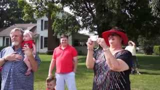 Download Military sons surprise parents by coming home and marching in hometown 4th of July parade Video