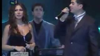 Download Ragheb Alama & Elissa - Betgeb Betrooh / راغب علامه و اليسا - بتغيب بتروح Video