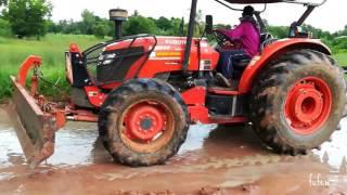 Download รถไถคูโบต้าทั้งใหญ่ ทั้งแรง เกรดดันดินดันทรายออกจากถนน Tractor KUBOTA M9540 Video