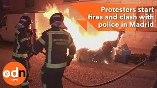 Download Protesters start fires and clash with police in Madrid Video