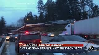Download SPECIAL REPORT | Amtrak train car dangling over Washington interstate after derailment Video
