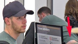 Download Nick Jonas Uses TENS Unit For Lower Back Pain Going Through LAX TSA Video