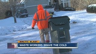 Download Sanitation workers brave the cold to get the job done Video