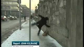 Download Guy falling on Snow / Ice in Dublin, RTE Six one report w/ Slow mo replay Video