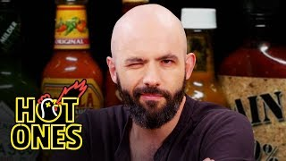 Download Binging with Babish Gets a Tattoo While Eating Spicy Wings | Hot Ones Video