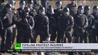 Download 'Crazy to stand against full-suit riot police': Dakota protester may lose her arm after clashes Video