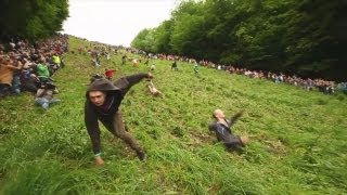 Download Gloucester Cheese Rolling 2012 OFFICIAL - World's Stupidest Competition Video